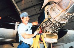 Kevin Rotteveel performing maintenance on Twin Otter Photo