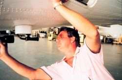 Mike Merek performing maintenance on NOAA aircraft Photo