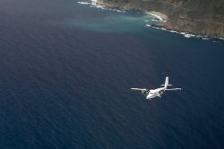 NOAA Twin Otter aircraft conducting marine mammal surveys off the Big Sur coastline. Photo