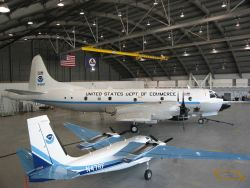 NOAA P-3 N42RF hurricane hunter and NOAA Rockwell Aero Commander AN47RF remote sensing mission aircraft in hangar at MacDill AFB. Photo