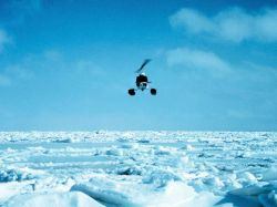 Bell helicopter operating over the ice floes of a frozen Bering Sea. Photo