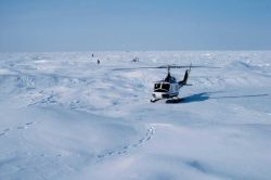 Bell UH-1M supporting through-ice current studies north of Prudhoe Bay for OCSEAP. Photo