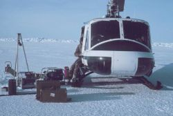 Bell UH-1M supporting through-ice CTD studies for OCSEAP Photo