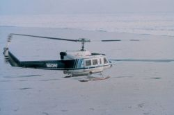 NOAA Bell 212 flying over North Slope of Alaska approaching the ice of the Beaufort Sea. Photo
