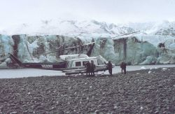 NOAA N58RF helicopter on ground by glacier front in South Central Alaska. Photo