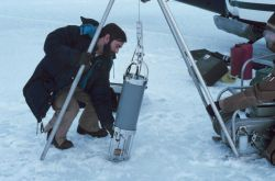 Helicopter pilot Bud Christman helping with science operations in the Beaufort Sea area. Photo