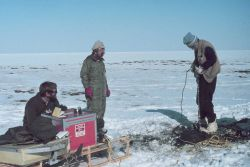 Scientists transported by helicopter drilling into permafrost as spring melting begins on Alaska North Slope Photo