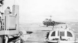 Contract Kern Helicopter flown off the Coast and Geodetic Survey Ship PIONEER, the first instance of a helicopter supporting ship operations for the C Photo