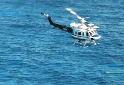 Bell 212 helicopter equipped with SHOALS Lidar sounding system off Cancun, Mexico Photo