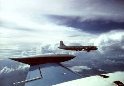 ESSA DC-6 38 Charlie flying over the tropical Atlantic. Photo