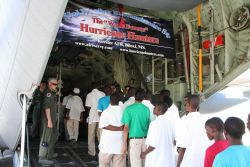 Some of the hundreds of visitors who toured the WC130-J Hurricane Hunter aircraft during its stop in Antigua in 2010 during a hurricane preparedness t Photo