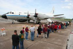 Visitors line up to board the NOAA P3 Hurricane Hunter plane during a stop in Beaumont during a Hurricane Awareness tour. Photo