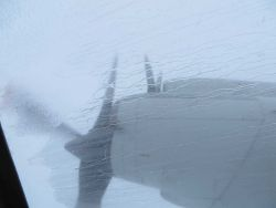 Rain streaking the windows of NOAA P-3 flying into Hurricane Edouard. Photo