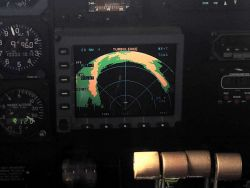 Eye of Hurricane Edouard as seen on cockpit radar display of NOAA P-3. Photo