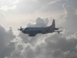 NOAA P-3 N42RF as seen from NOAA P-3 N43RF during Hurricane Fabian missions. Photo