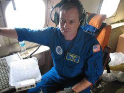 Joe Bosko monitoring computer Photo