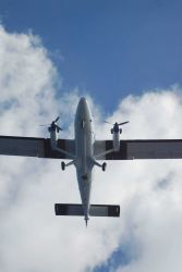 NOAA Twin Otter aircraft flying over NOAA Ship PISCES during Deep Water Horizon disaster. Photo