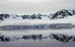 Glacier and mountains across a Norwegian fjord at Svalbard. Photo