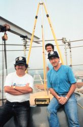 L to R - David Doyle, Roy Anderson, and Dennis Hoar are atop the Capitol Building during GPS surveying operations. Photo