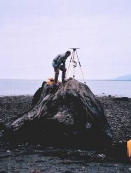 Mike Aslaksen setting up GPS receiver over tidal bench mark. Photo