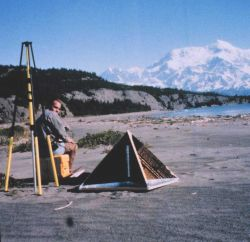 Mike Aslaksen setting up GPS antenna over radar reflector which was used for controlling airborne synthetic aperture radar survey Photo