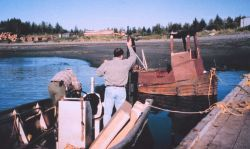 Loading equipment in skiff to transport radar reflectors, GPS antennas, etc Photo