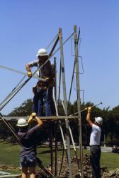 Fred Buck on tower beginning construction of Bilby tower. Photo