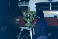 Ross Mackay observing astronomic latitude and longitude with Wild T-4 Theodolite Photo