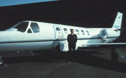 Pilot, Commander Bob McCann, standing by NOAA Cessna Citation II N52RF at Dulles International Airport. Photo