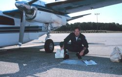 Lieutenant Commander Greg LaMontagne planning aerial photographic mission on Rockwell Turbo Commander N53RF. Photo