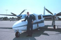 Aerial photographer Sean Linehan with the Rockwell Turbo Commander N53RF. Photo