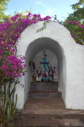 A shrine draped with bougainvillea, reminiscent of California missions. Photo