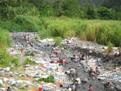 Sao Tomean Women Washing Laundry at River Photo