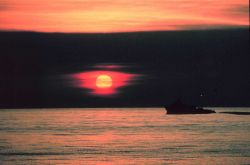 A gulf crew boat silhouetted in a Gulf of Mexico sunset Photo