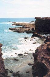 Sharp hard rocky shoreline Photo