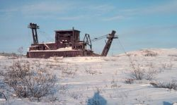 An old gold dredge west of Nome. Photo