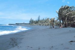 Black lava sand beach known locally as the