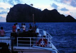 Science party on the bow taking in the sights while approaching Necker Island on the NOAA Ship TOWNSEND CROMWELL Photo