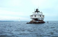 The Thomas Point Lighthouse just north of the mouth of the South River below Annapolis Photo