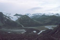 Mountains, glacial valleys, and a river valley on a gray day in Redoubt Volcano area. Photo