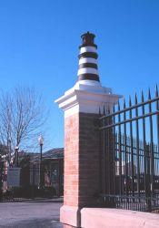 A decorative lighthouse graces the entrance to the United States Coast Guard Base at Charleston. Photo