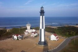 Cape Henry Lighthouse as seen from the top of Old Cape Henry Lighthouse. Photo