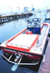 A harbor patrol boat at the commercial port Photo