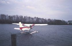 Seaplane taking off from the Tchefunte River to East Timbalier Island area. Photo