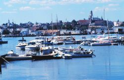 Yachts and workboats intermingling in Gloucester Harbor. Photo