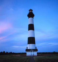 A view of the Bodie Island Lighthouse at sunset Photo