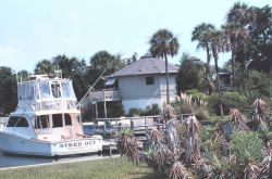 Recreational fishing boat and vacation home Photo