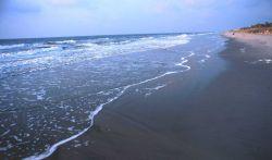 Gentle surf on the Folly Island Beach Photo