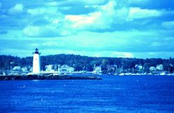 A view of the lighthouse guarding the harbor entrance. Photo