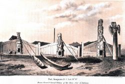 Native dwellings and totem poles at Port Simpson, British Columbia Photo